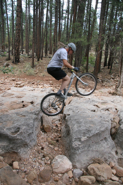 A gap or surge across a small crevice.  You need to explode upwards and forwards to clean it with a pedal kick.