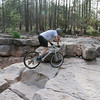 Moving around to position the front wheel up on the last rock in the sequence.