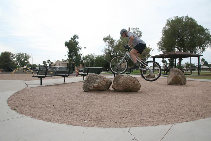 Explode upwards to get the bike up on both rocks.