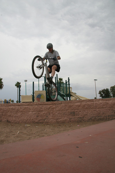I practice rolling off edges here.  You lower the front wheel, compress then roll off the edge (not jump).  To finish, extend your legs and bring the bars up toward your waist.  It makes for a more graceful trials style landing.  If it goes bad the sand eases the fall.