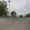 I'm continuing to level the bike by scooping it up with me using a smear on the pedals.  I'll land two wheels together.  Note the foot angle.  Zoomers should learn to NOT YANK THE BIKE UP WITH SNAP IN PEDALS!!!  Riding involute curves is unique and good practice.  This is kiddie crap compared to what the BMX riders can do here.