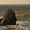Triangle rock, stormy with churned sea