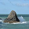 Triangle rock, strong wind white horses and spray, bright