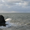 Triangle rock, grey seascape and spray