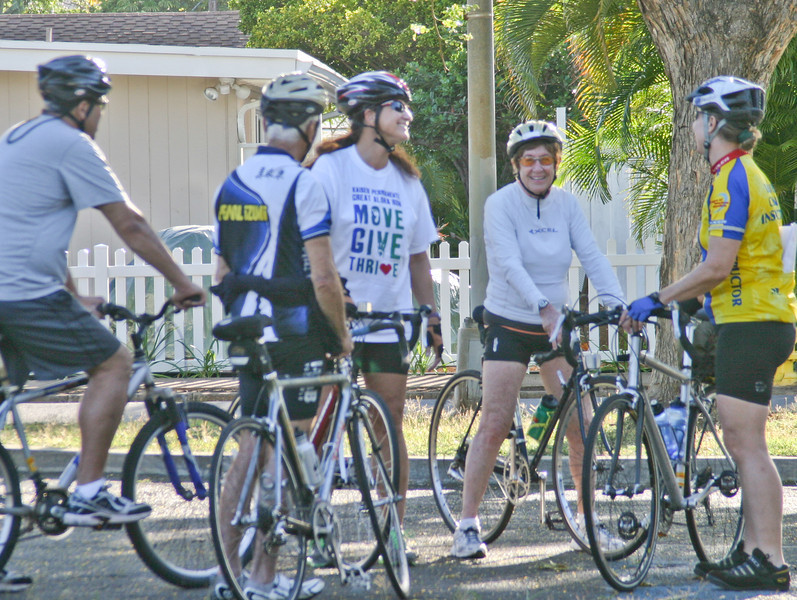 The group gathers for a flat tire clinic after a bike ride in Kahala