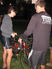 Nick helps Christine with her bike