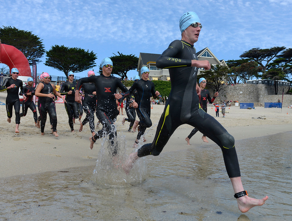 . Competitors enter the water during swim leg of the junior the Elite Race during the Triathlon at Pacific Grove on Saturday June 11, 2016. (David Royal - Monterey Herald)