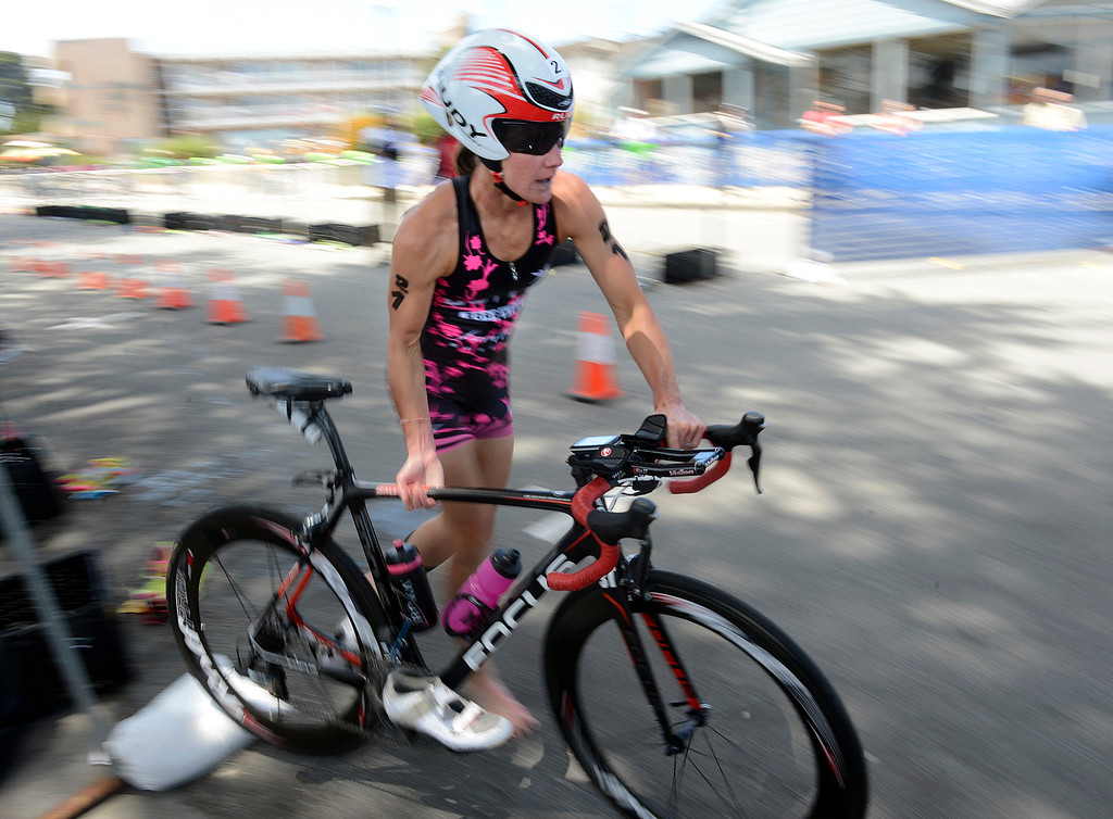 . Emily Cox of Napa leaves the transition zone to start the bike leg of the  women\'s Elite Race during the Triathlon at Pacific Grove on Saturday June 11, 2016. Cox placed second in the race. (David Royal - Monterey Herald)