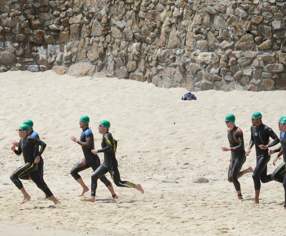 . The pack of male swimmers head for the water at Lovers Point during the start of the Mens Elite Race during the Triathlon at Pacific Grove on Saturday June 11, 2016. Zaferes won the race. (David Royal - Monterey Herald)