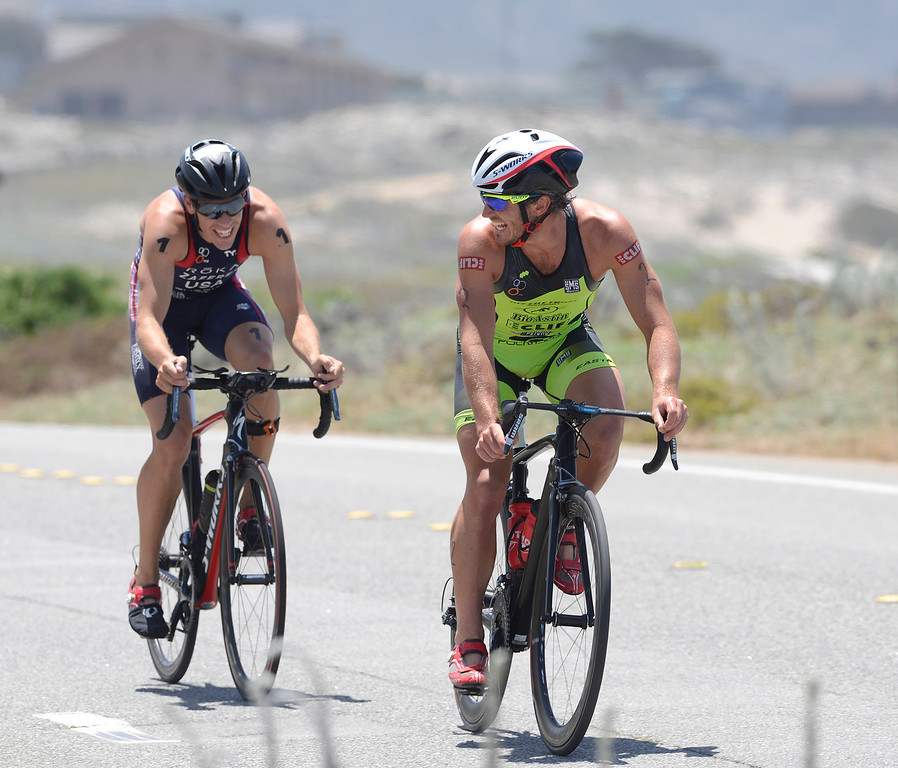 . Tommy Zaferes, left, of Aptos and Davide Giardini of Italy share a light moment as the ride near Asilomar State Park during the biking leg of the Mens Elite Race during the Triathlon at Pacific Grove on Saturday June 11, 2016. Zaferes won the race, Giardini placed second. (David Royal - Monterey Herald)