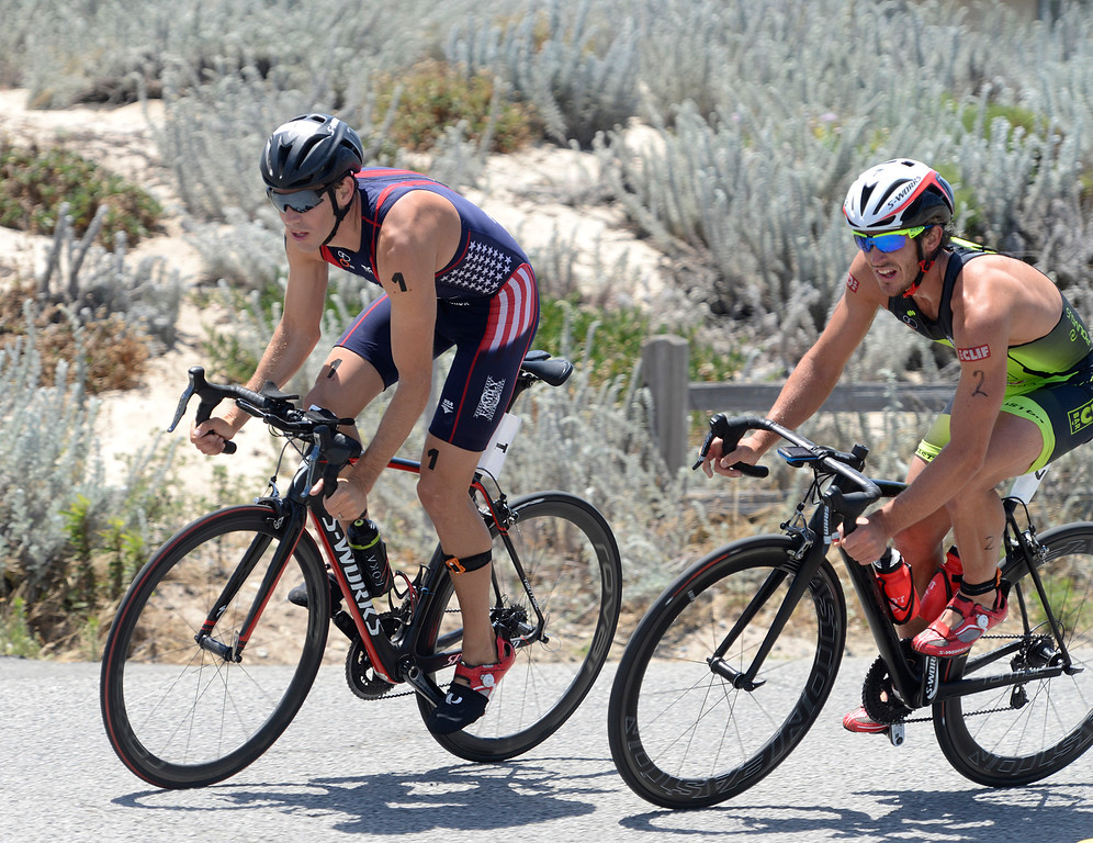 . Tommy Zaferes, left, of Aptos leads Davide Giardini of Italy near during the biking leg of the Mens Elite Race during the Triathlon at Pacific Grove on Saturday June 11, 2016. Zaferes won the race, Giardini placed second. (David Royal - Monterey Herald)