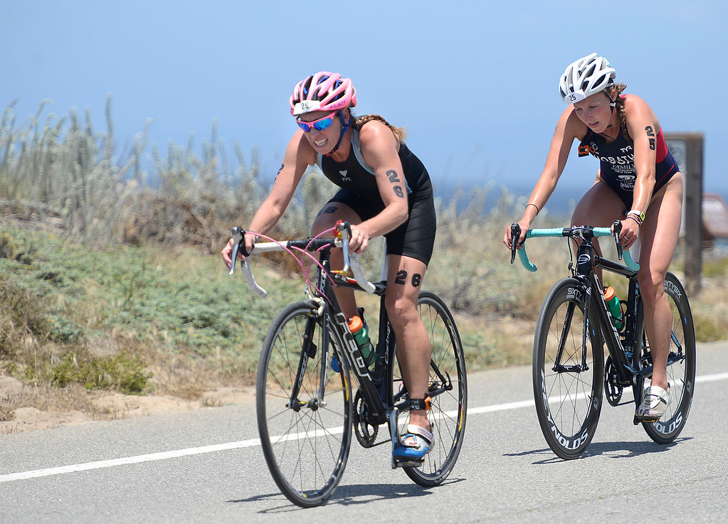 . Alexis Smith of Seaside leads Gina Horath of Aptos during the bike leg of the women\'s Elite Race during the Triathlon at Pacific Grove on Saturday June 11, 2016. (David Royal - Monterey Herald)