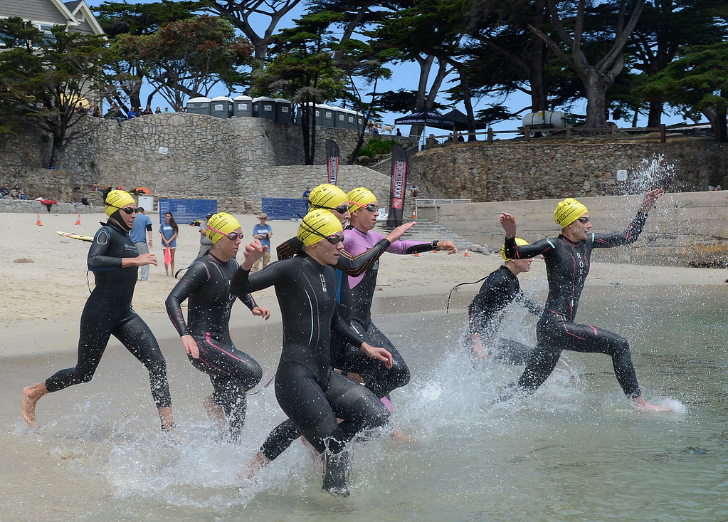 . Female competitors enter the water at Lovers Point during swim leg of the women\'s the Elite Race during the Triathlon at Pacific Grove on Saturday June 11, 2016. (David Royal - Monterey Herald)