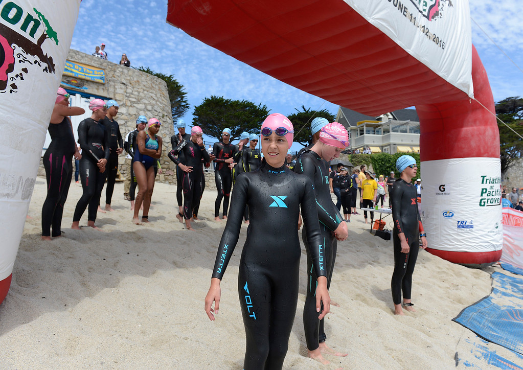 . Young triathletes get ready before the start of the junior Elite Race during the Triathlon at Pacific Grove on Saturday June 11, 2016. (David Royal - Monterey Herald)