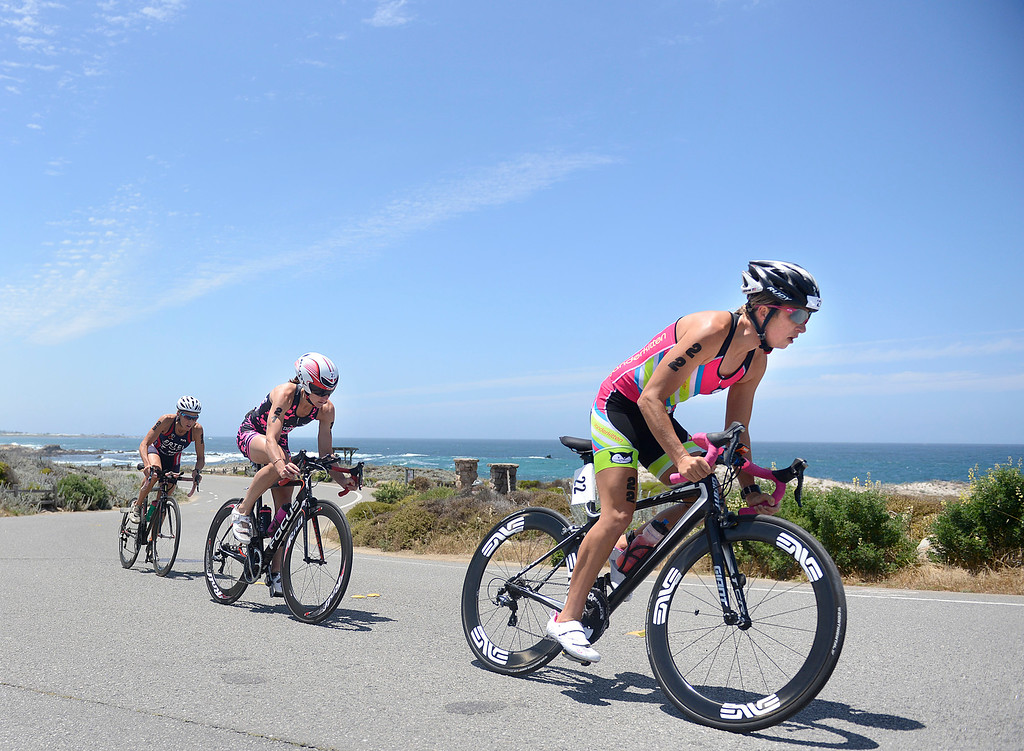 . Kelsey Withrow, right, of Pleasant Hill leads Emily Cox of Napa and Julie Ertel of Irvine during the bike leg of the Triathlon at Pacific Grove at Lovers Point duing the women\'s Elite Race on Saturday June 11, 2016. Ertel won the race, Cox placed second and Withrow finished third. (David Royal - Monterey Herald)