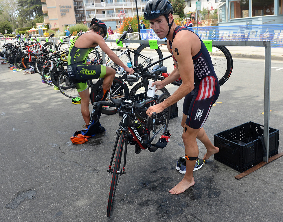 . Tommy Zaferes leads Davide Giardini of Italy out of the transition zone from the swim to the biking leg of the Mens Elite Race during the Triathlon at Pacific Grove on Saturday June 11, 2016. Zaferes won the race, Giardini placed second. (David Royal - Monterey Herald)