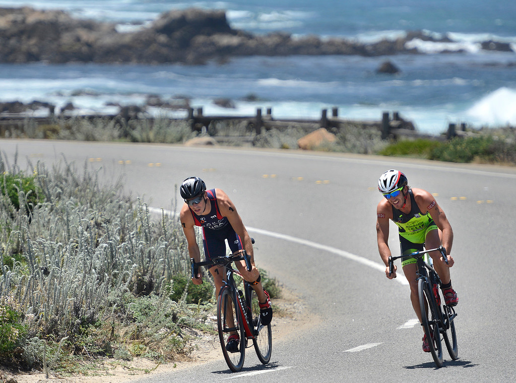 . Tommy Zaferes, left, of Aptos and Davide Giardini of Italy ride near Asilomar State Park during the biking leg of the Mens Elite Race during the Triathlon at Pacific Grove on Saturday June 11, 2016. Zaferes won the race, Giardini placed second. (David Royal - Monterey Herald)