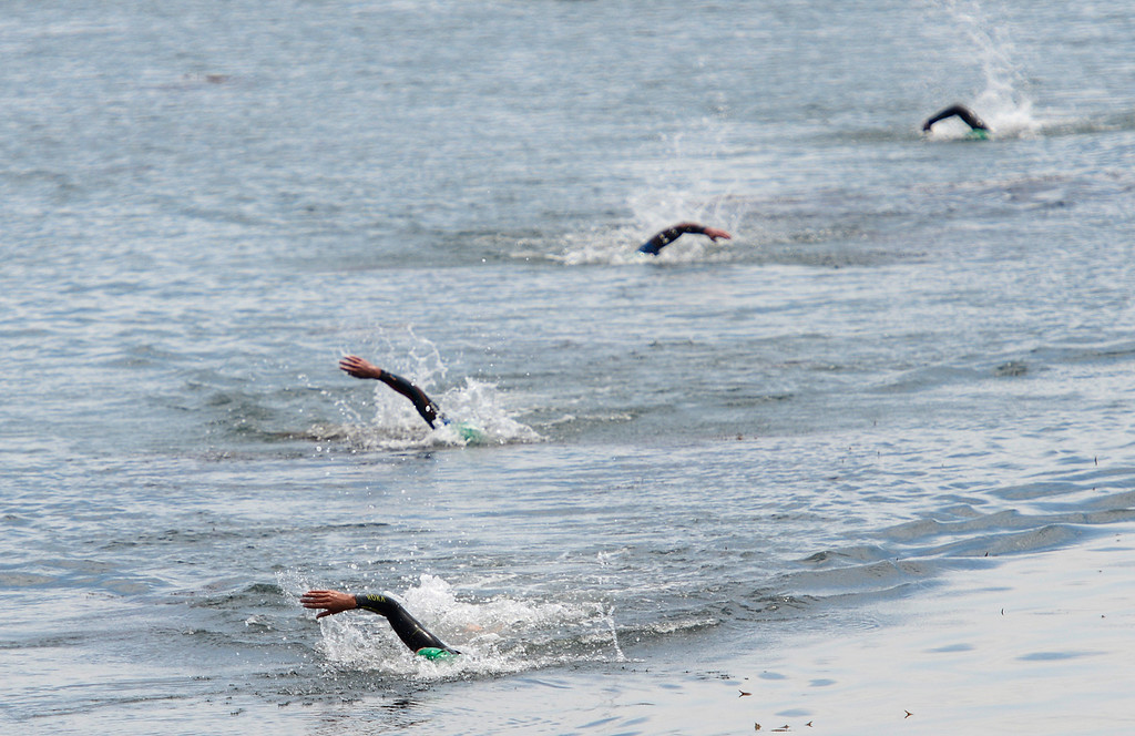. Tommy Zaferes leads a pack of male swimmers toward shore at Lovers Point during the swimming leg of the Mens Elite Race during the Triathlon at Pacific Grove on Saturday June 11, 2016. Zaferes won the race. (David Royal - Monterey Herald)