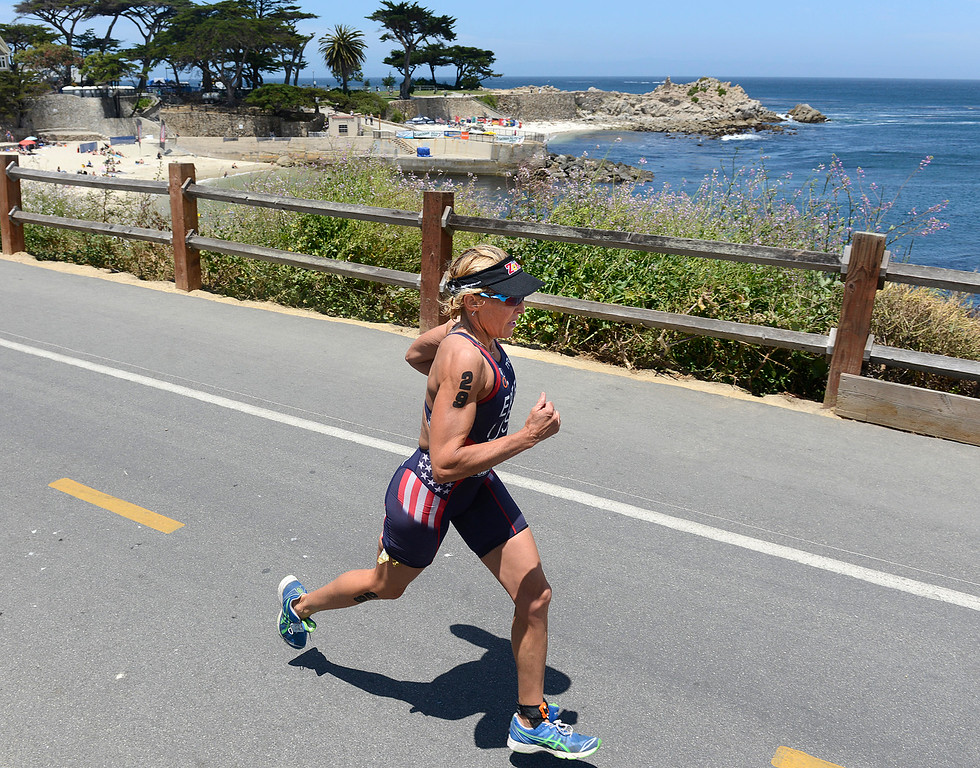 . Julie Ertel of Irvine runs the final leg of the Triathlon at Pacific Grove above Lovers Point on her way to winning the women\'s Elite Race on Saturday June 11, 2016. (David Royal - Monterey Herald)