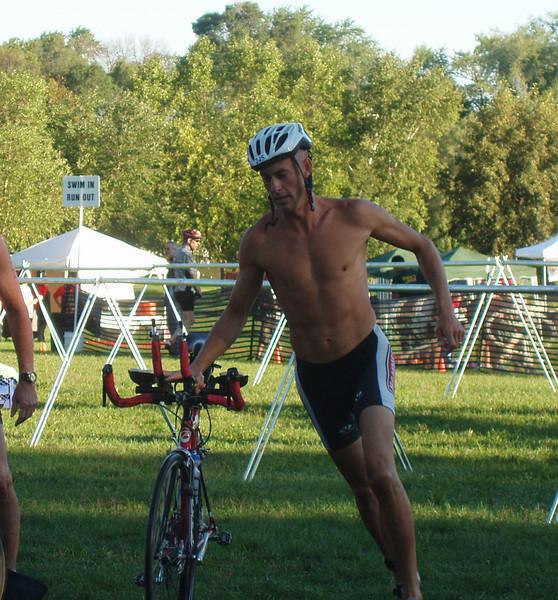 Ryan leaving the transition area to start the bike leg.