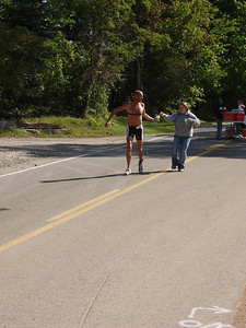 Ryan Robinson grabs water at around the 1.8 mile mark in the 10K run.