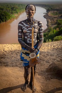 The Karo tribe is probably the one you've seen on the internet.  They are quite inventive in their 'dress' and actually quite friendly