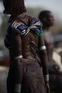 The women take great pride in showing off their scars.  In the Hamar culture allowing the husband to strike you with a switch was a mark of love and the scars the proof.  Not what we would accept in our world.