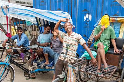 Hamming it up. Rickshaw drivers.