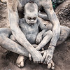 Baby Mundari covered in ash