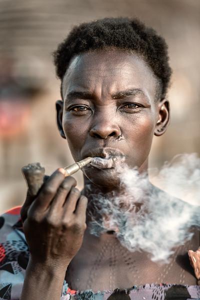 Boya tribes woman smoking
