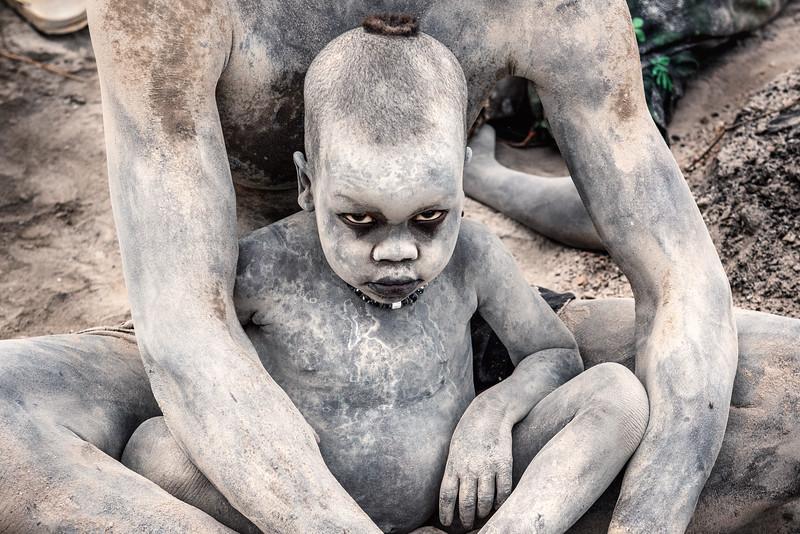 Baby Mundari covered in ash, Kworonit