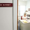 Linda McKinney is the case manager for the Tribunal. She is seen working at her desk. (Photo by Adrean Indolos / NTC)
