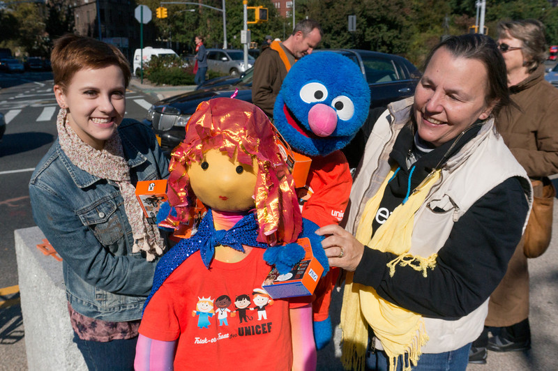 Diane and a volunteer holding Diane's puppets. They're promoting the UNICEF collection campaign of Brooklyn For Peace.