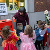 BFPs Jane Kurinsky, hands out UNICEF collection boxes to Park Slope trick or treaters.