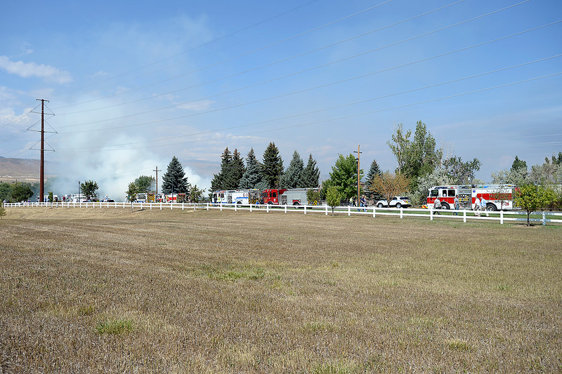Firetrucks line Trilby Road as firefighters battle a house fire at 1504 W. Trilby Road  Thursday, Sept. 1, 2016, between Loveland and Fort Collins. Officials said the home was unoccupied and no one was injured. (Photo by Jenny Sparks/Loveland Reporter-Herald)