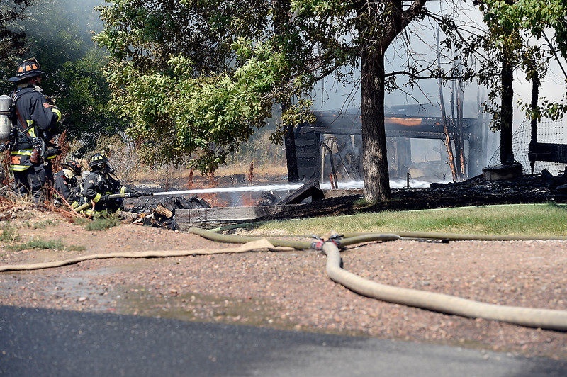 Poudre Fire Authority firefighters battle a house fire at 1504 W. Trilby Road Thursday, Sept. 1, 2016, between Loveland and Fort Collins. Officials said the home was unoccupied and no one was injured. (Photo by Jenny Sparks/Loveland Reporter-Herald)