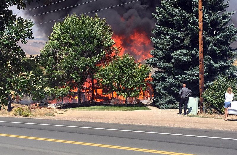 A home at 1504 W. Trilby Road is engulfed in flames Thursday, Sept. 1, 2016, between Loveland and Fort Collins. Officials said the home was unoccupied and no one was injured. (Photo by Chris King/Special to the Reporter-Herald)