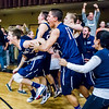 Trinity's Josh Mumper is mobbed by teammates after hitting a buzzer beater 3 to win the game over SCCS. Final score Trinity 50, SCCS 47.