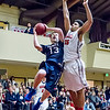 Trinity's Ian Caddow (#13) goes in for a layup against SCCS's Christopher Collins (#35). Trinity won the game 50-47 on a 3-pt buzzer beater by Trinity's Josh Mumper.