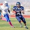 20131011 - Trinity RB/WR Spencer Klehn (#4) gets past Desert Christian's Sean Miller (#6) during the Trinity v Desert Christian football game held at West Ranch HS. Trinity won 48-0.