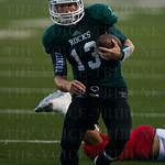 Rocks\' QB Jake Woosley (13) ran the ball up the sideline.