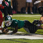 Larry Harper III (3) pushed his way into the end zone for one more Trinity score.