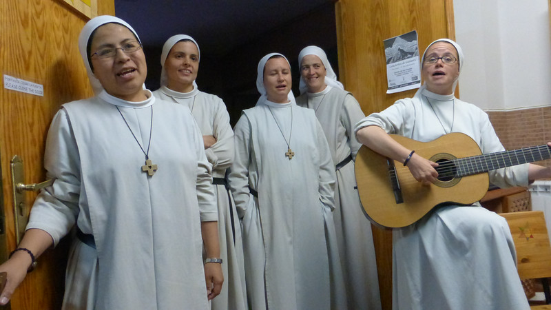 Nuns Singing Before Serving Communal Dinner to Pilgrims
