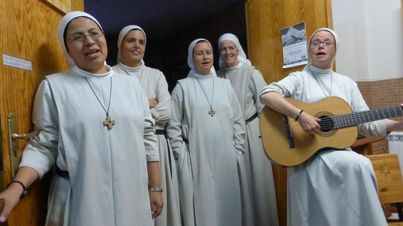 Nuns Singing Before Serving Communal Dinner to Pilgrims