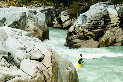 """Harold Schaefer enters """"The Pinch"""" on Fear Canyon of the Elaho River outside Squamish, British Columbia."""