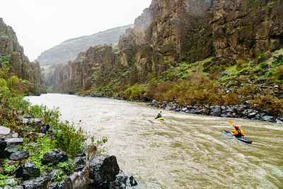 Christian Woodard and Daphnee Tuzlak paddling through the desert canyons of the Middle Owyhee during a surprise May snowstorm.