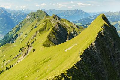 Hikers heading north from the Brienz train station along the ridge towards Interlaken, Switzerland.