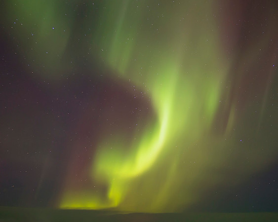 This photograph of the aurora borealis or northern lights was captured in Iceland (1/16). This photograph is protected by International and U.S. Copyright Laws and shall not to be downloaded or reproduced by any means without the formal written permission of Ken Conger Photography.