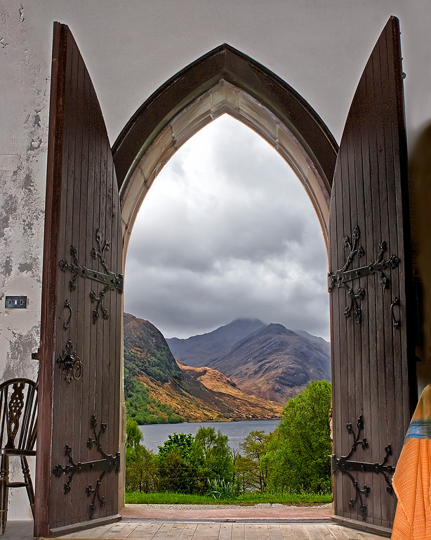 Photograph looking out the door of St. Mary and St. Finnan Catholic Church in Glenfinnan, Scotland (5/06)