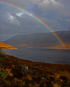 This is a photograph of a rainbow above a unknown loch in Scotland (5/06).